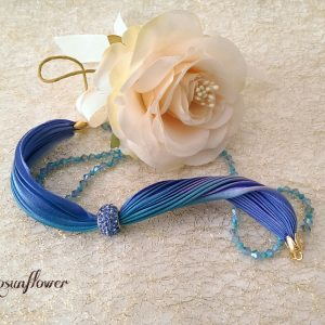 Bracciale di seta e cristalli di swarovski viola e azzurro